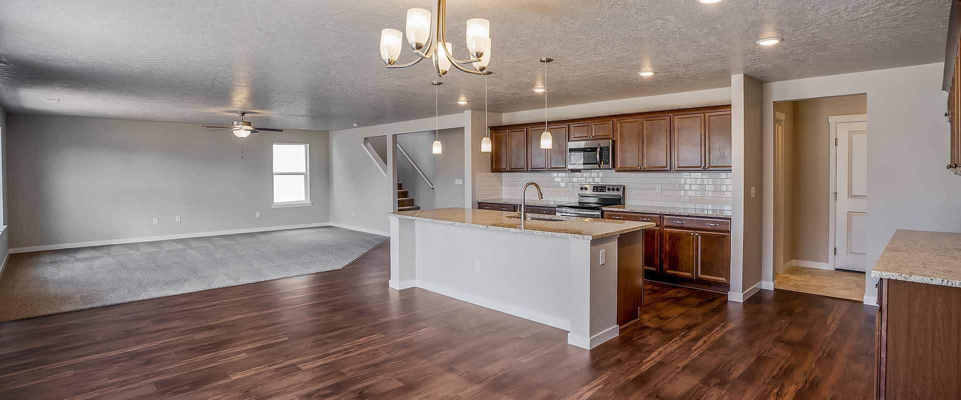 Cedar_Hubble_Homes_New_Homes_Boise_0002_Charter Pointe Cedar 7529 Foremast -6 Kitchen Great Room.jpg